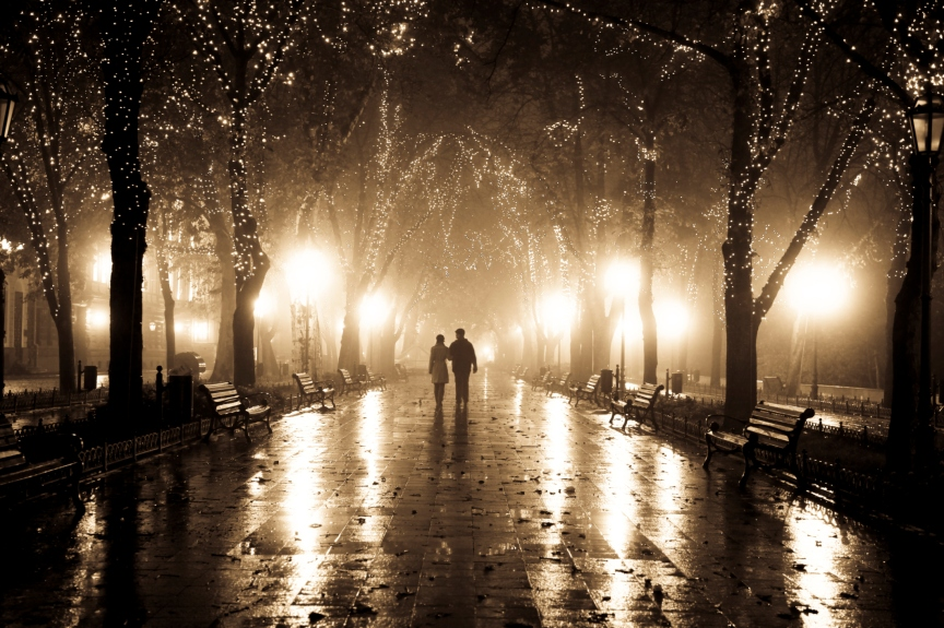 Couple walking in night lights.