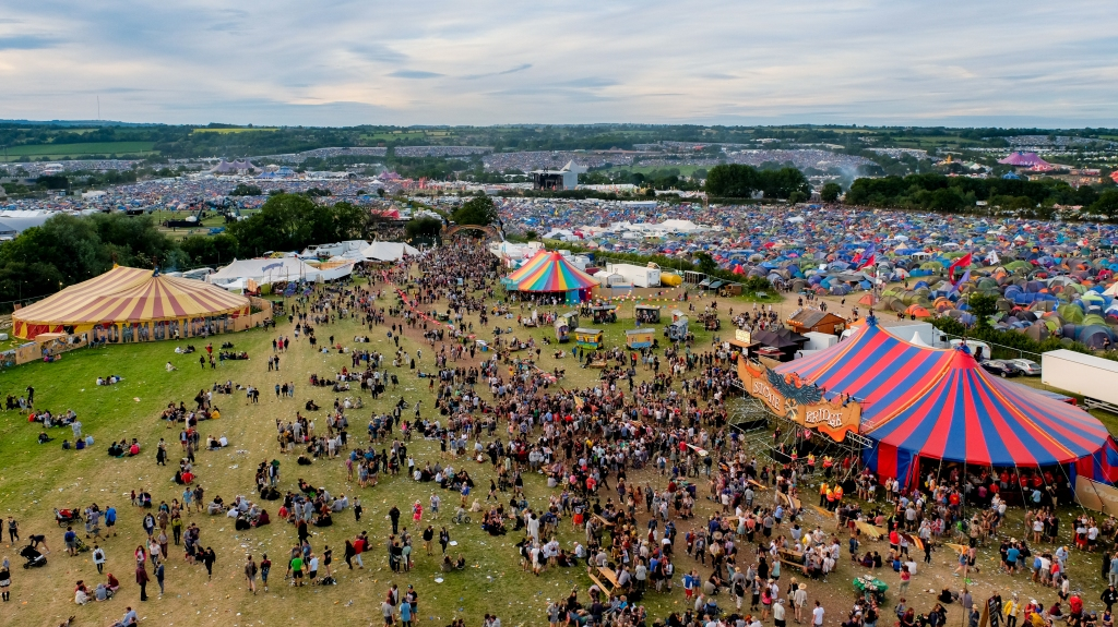 Glastonbury Festival, Somerset, UK. 25 June 2015. Aerial view of part of the Glastonbury Festival site from the Ribbon Tower. © Tom Corban