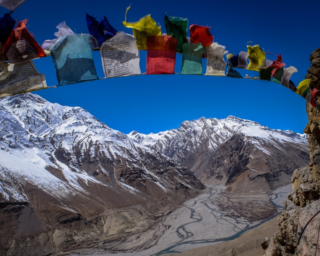 Spiti Valley, Himachal Pradesh, India. Buddhist prayer flags at Dhakar Monastery with the floor of the Spiti valley in the background.