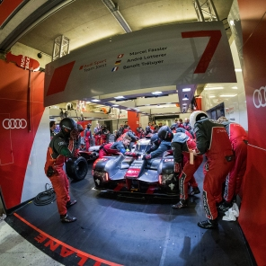 Teh no7 Audi R18 being worked on in the Audi garage after it stopped to repair damage to the front of the car.