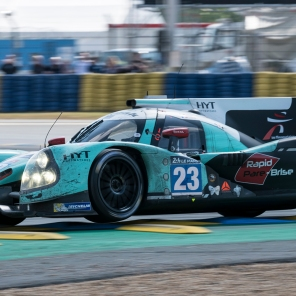 The no23 Panis Barthez Competition Ligier hopping over the kerbs at the final corner of the 13.6km Le Mans circuit.
