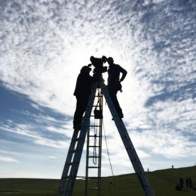Camera crew on ladders