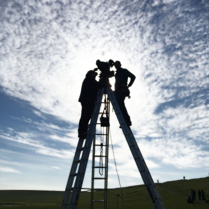 Camera crew on ladders